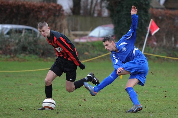 Ardington's Jonny Eudell (right) tangles with Dorchester's Sam Buckett