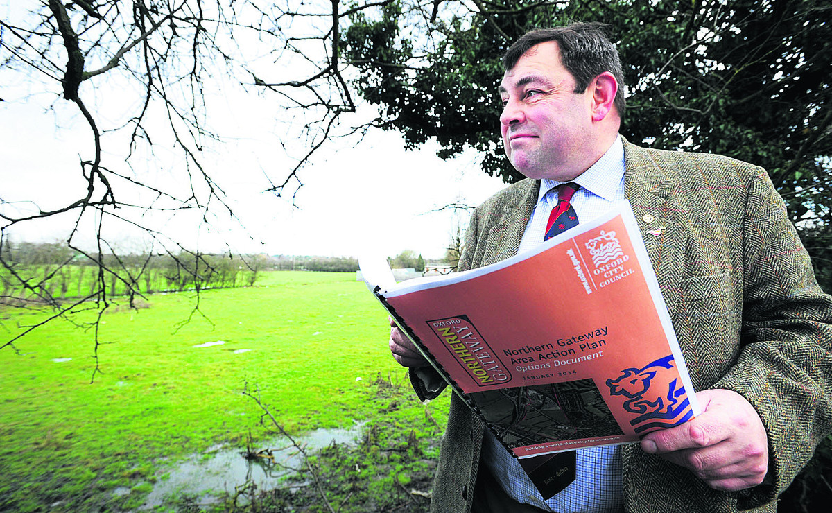 Cllr Colin Cook overlooking the triangle of land bounded by the A40, A34 and A44