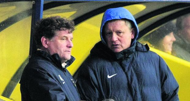 Oxford Mail: Mickey Lewis and Chris Wilder discuss tactics on Saturday