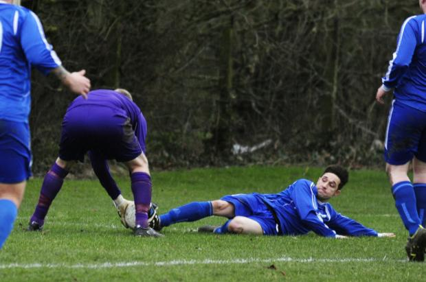 Steventon keeper Stuart Tofte has his hands on the ball, but Hendred's Shane Tripp slides in, causing a brief confrontation