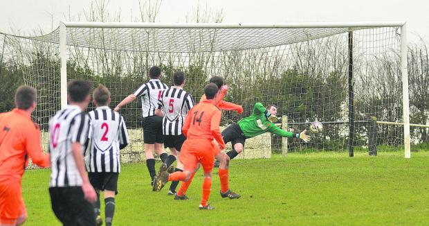 Stephen Burke scores Minster Lovell's goal in their 7-1 defeat at Chipping Norton Town