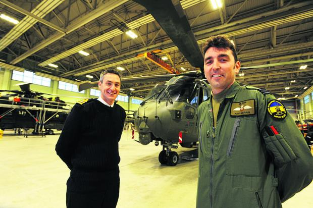 CHANGES: Squadron Leader Kevin Harris, right, and Commander Steve Doubleday MA RN of the Commando Helicopter Force