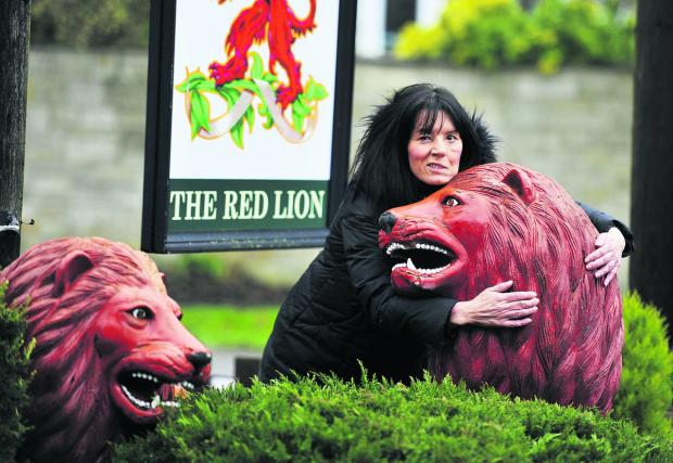 Landlady Chrissie Jones is selling the two red lions from her Yarnton pub. Picture: OX64992 Mark Hemsworth