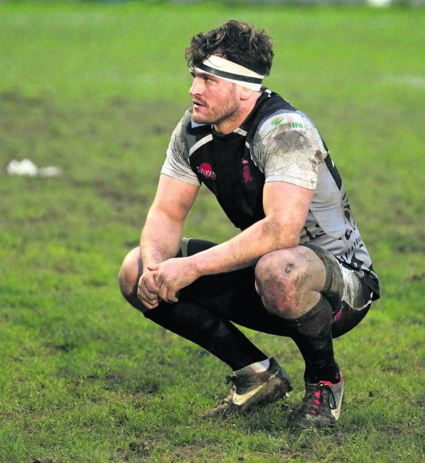 Oxford Mail: London Welsh back row forward Mike Denbee shows his disappointment after their shock defeat away to Plymouth  Albion.  Picture: Martin John