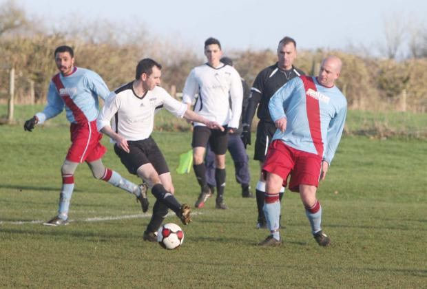 Eynsham's Lee Rainbow is under pressure from Bletchingdon's Lee Jones