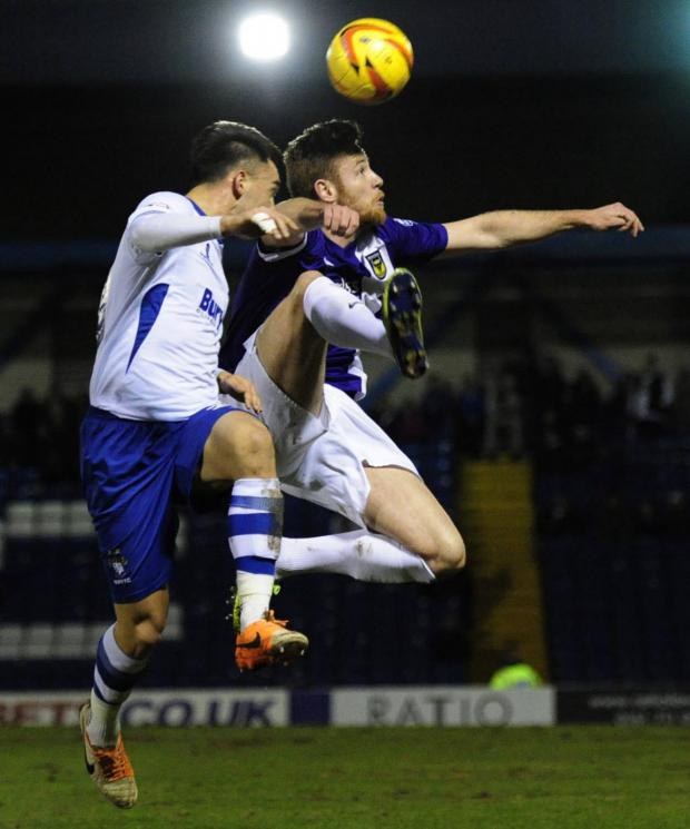 Oxford Mail: Oxford United's Deane Smalley leaps high for a header at Bury