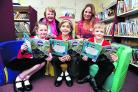 Stanford in the Vale Primary School has taken part in the reading campaign. Pictured, from left, are pupils Lilly Amies, Sofia Seijido and Owen Hill with, back, county councillor Melinda Tilley, left, and headteacher Amanda Willis