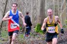 Woodstock's James Bolton (1619) battles it out with Oxford City's Les Newell en route to securing the vet 40 men's title