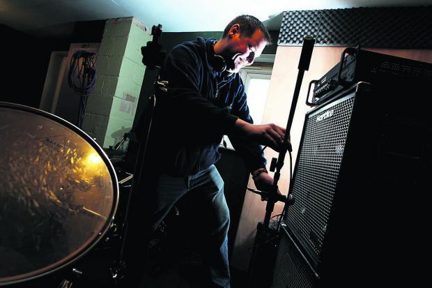 Oxford Mail: Gavin Hyatt sets up the recording room