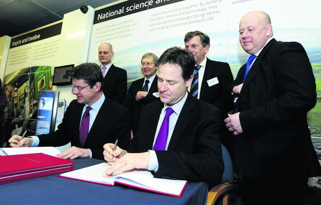 Nick Clegg signs off the City Deal sitting next to Greg Clark, the Cities Minister