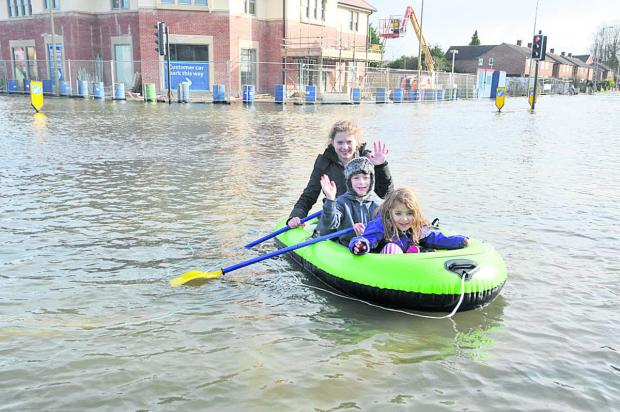 Oxford Mail: Two of Tim Bowley's children Isabella Bowley, 12, front and Lucia Bowley, six, rear, with friend Max Bridson in a dinghy in Abingdon Road