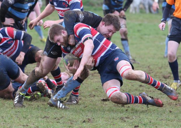 Oxford Mail: Witney's Jamie Burke tackles Grove's Paul Miles during their 17-0 win