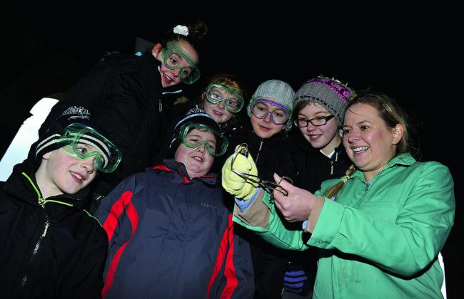 Ready to experiment with lighting a magnesium strip is festival organiser Renee Watson with young science boffins, from left, Owen Reynolds-Pound, Millie Jones, Oliver Curtis, Ellie Knight, Ellie Phillips and Holly Washbrook
