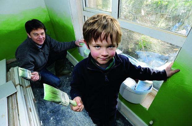 Tim Nicholson gets some help redecorating the house from son Benjamin, six