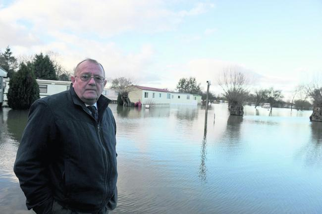Councillor Rodney Rose at the flooded Bablockhythe caravan park in January.  Picture: OX64553 Denis Kennedy