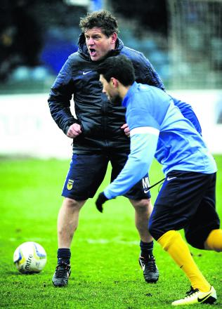 Mickey Lewis shouts the orders as he takes the pre-match warm-up at Bristol Rovers last week