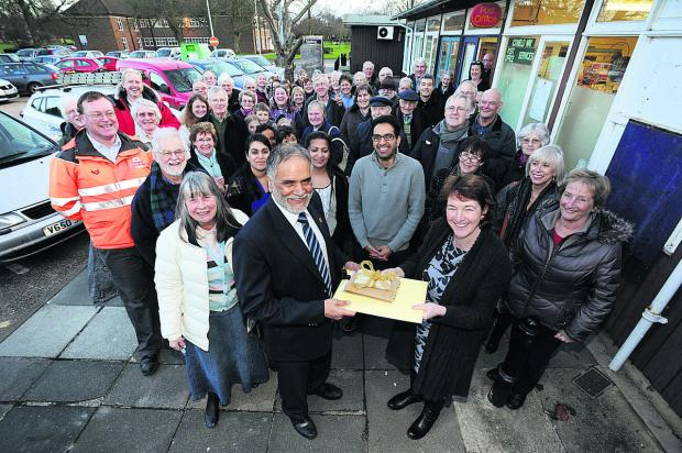 Oxford Mail: Gurmit Dhendsa, front centre, with Judy Goodall, left, and Rachel Downey with well-wishers in Harwell  Picture: OX65151 Jon Lewis