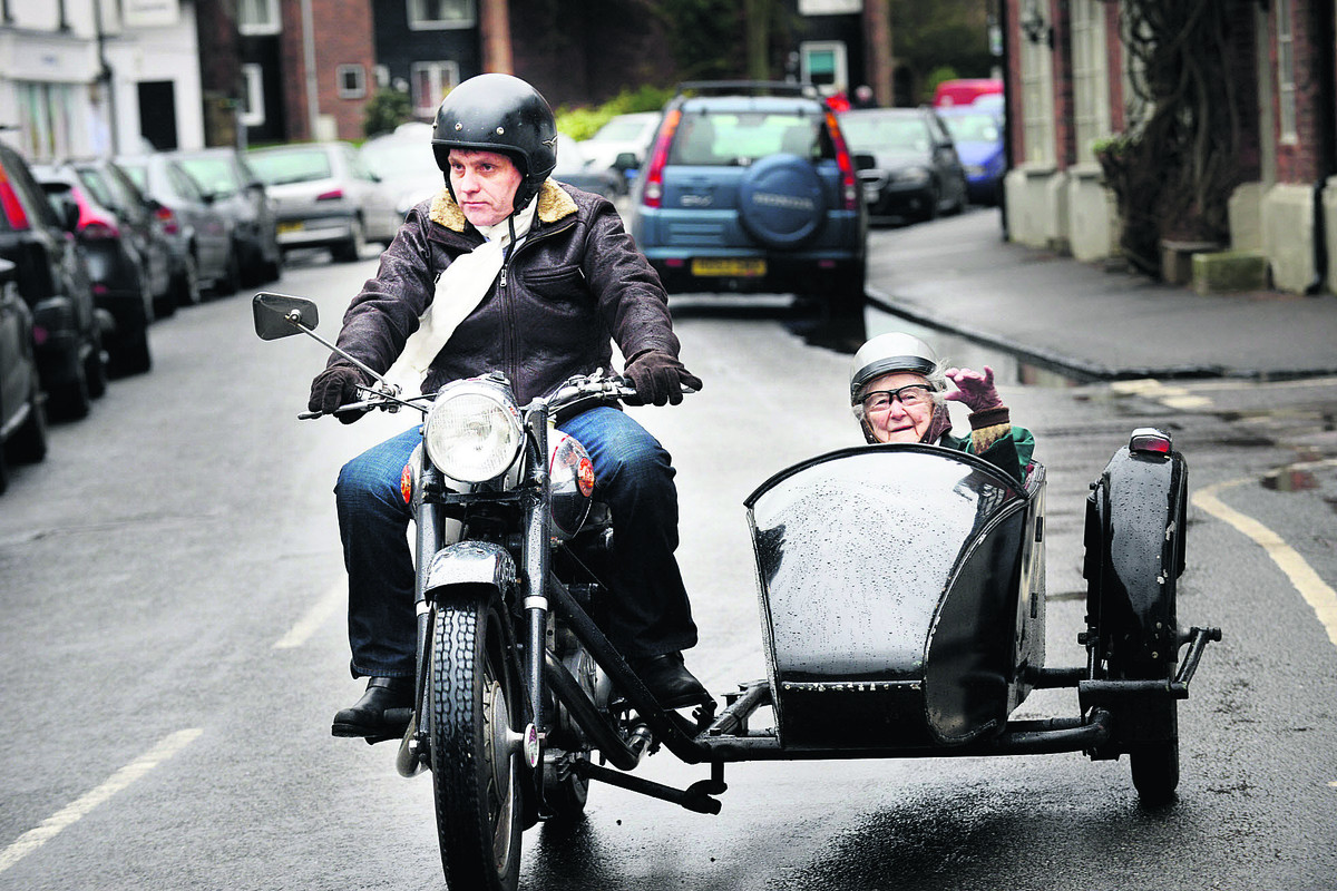 Landlord  of The Bear Hotel  Liaan van Zyl takes  Mary Tame for a jaunt on a 1955 Triumph Bonneville Panther motorbike and sidecar   Picture: OX65076 Richard Cave