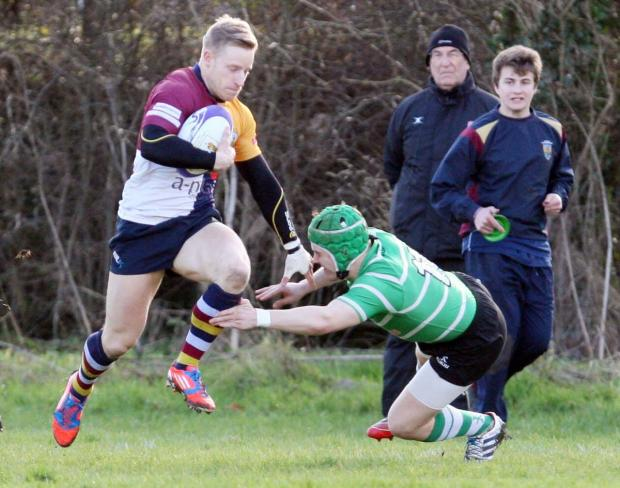 Three-try Jack Robinson on the charge for Quins against Buckingham