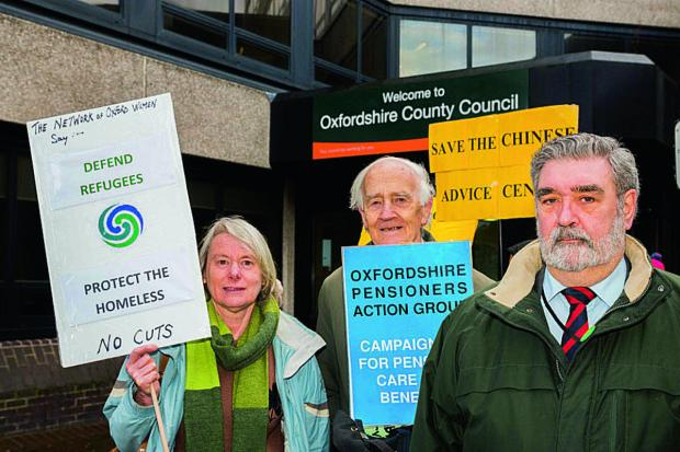 Oxford Mail: Showing their opposition yesterday, from left, Carol Stavris, Network of Oxford Women; Michael Hugh-Jones, Secretary of Oxford Pensioners Action Group; and Cllr David Williams of the Green Party. Picture: OX65403 Greg Blatchford