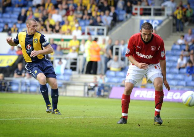 Oxford Mail: James Constable fires home his hat-trick goal against Morecambe at the Kassam Stadium in September 2010