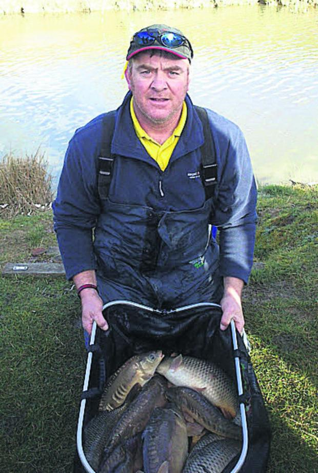 Oxford Mail: Littlemore's Mark Shepherd with his bag of carp from Panshill