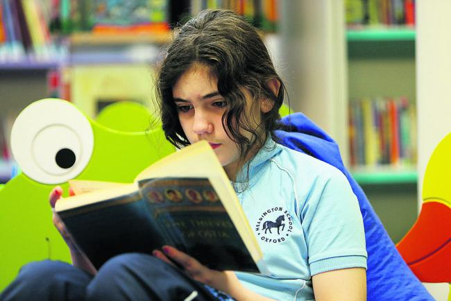 Prep school pupil Eloise Kirkpatrick gets absorbed in a book ready for next week's event