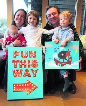 BRAINWAVE: Rhian and Jez Kicks with children, from left, Idris, Carys and Arlo