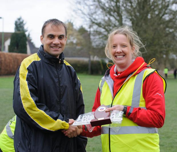 Paul Fernandez receives his winner's trophy from race director Ellie Barnes    Picture: Gareth Jones, Sports-alive Photography