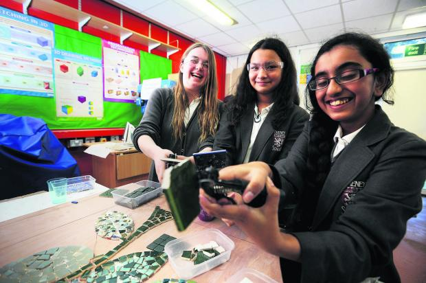 From left, Beth Aveyard, 13, Lana Pagnier, 12, and Brighty Varughesekakkunnathu, 12, work on the mosaic for the tower at Cheney School, Headington   Picture: OX65412 Jon Lewis