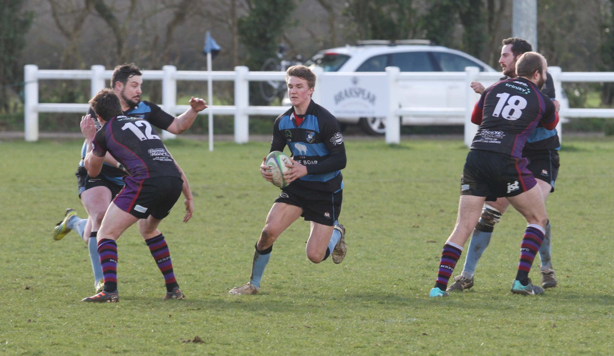 Witney fly half Ted Landray goes through a gap during their 25-11 victory over Maidenhead