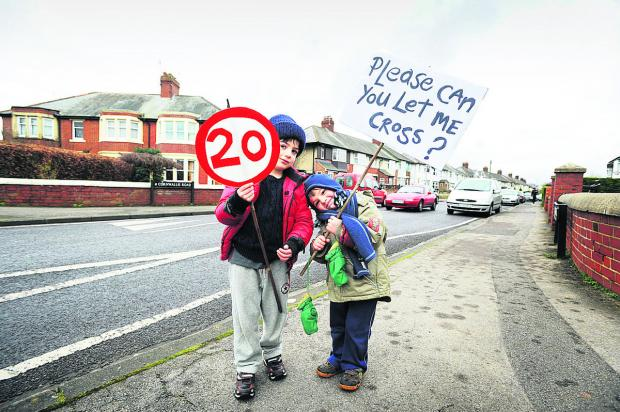 Oxford Mail: Leo, left, and Joseph Noble at the Cornwallis Road protest Picture: OX65583 Jon Lewis