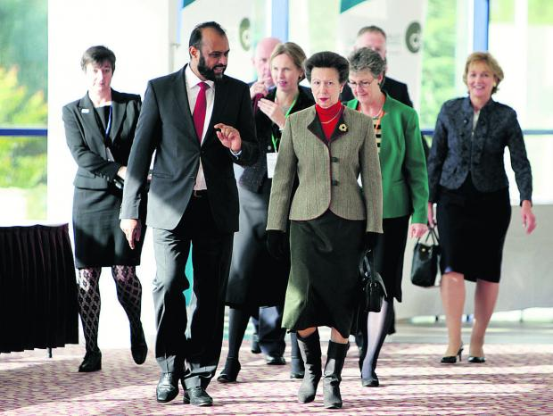 Oxford Mail: Victim Support chief executive Javed Khan leads the Princess Royal into the conference at Oxford's Kassam Stadium in 2012; below, volunteer Sheila Spencer