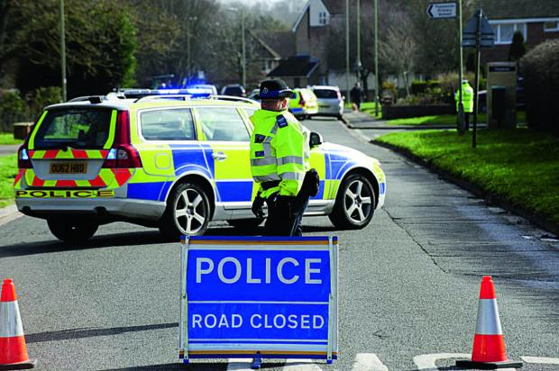 Oxford Mail: Police shut off the area at the junction of Kensington Close and Preston Road after the accident.