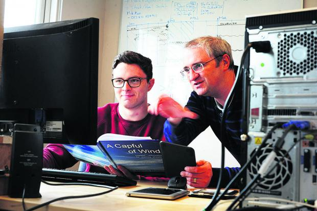 Oxford Mail: REWARDING: Apprentice Nick Bracey, left, with Andy Severn who runs Oxford e-Books Ltd.