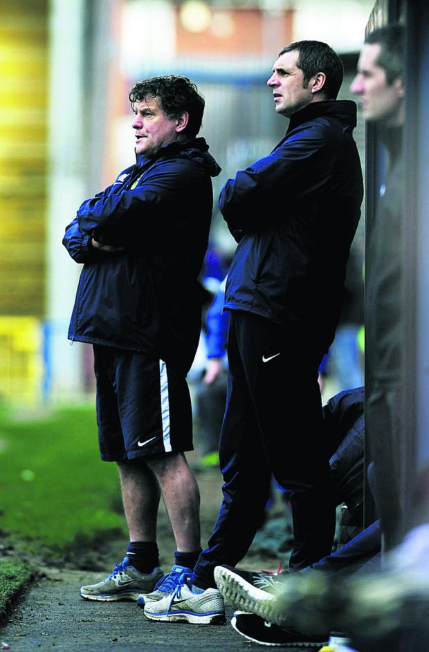 Oxford Mail: Oxford United caretaker manager Mickey Lewis (left) and first-team coach Andy Melville look on during the 3-0 loss at Rochdale Picture: David Fleming
