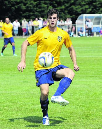 Jon Meades, pictured in the pre-season game at Ardley United is back in training after seven months out with an ankle injury