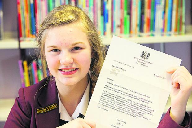 Oxford Mail: Tara Paxton-Doggett with her letter from David Cameron's office