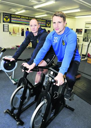 Oxford United player Nicky Wroe, right, and Alasdair Lane, the club's head of sport science, train for the Blenheim Triathlon Picture: OX65768 Mark Hemsworth