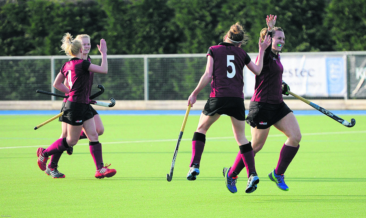 Kirsty Chapman celebrates with teammate Becky Hibbert (5) after putting Hawks into a shock lead against Slough.