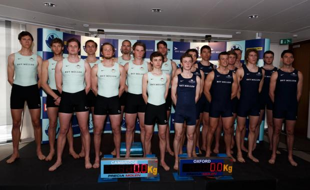 Crews from Cambridge (left) and Oxford prepare to take to the scales at the BNY Mellon Centre, London