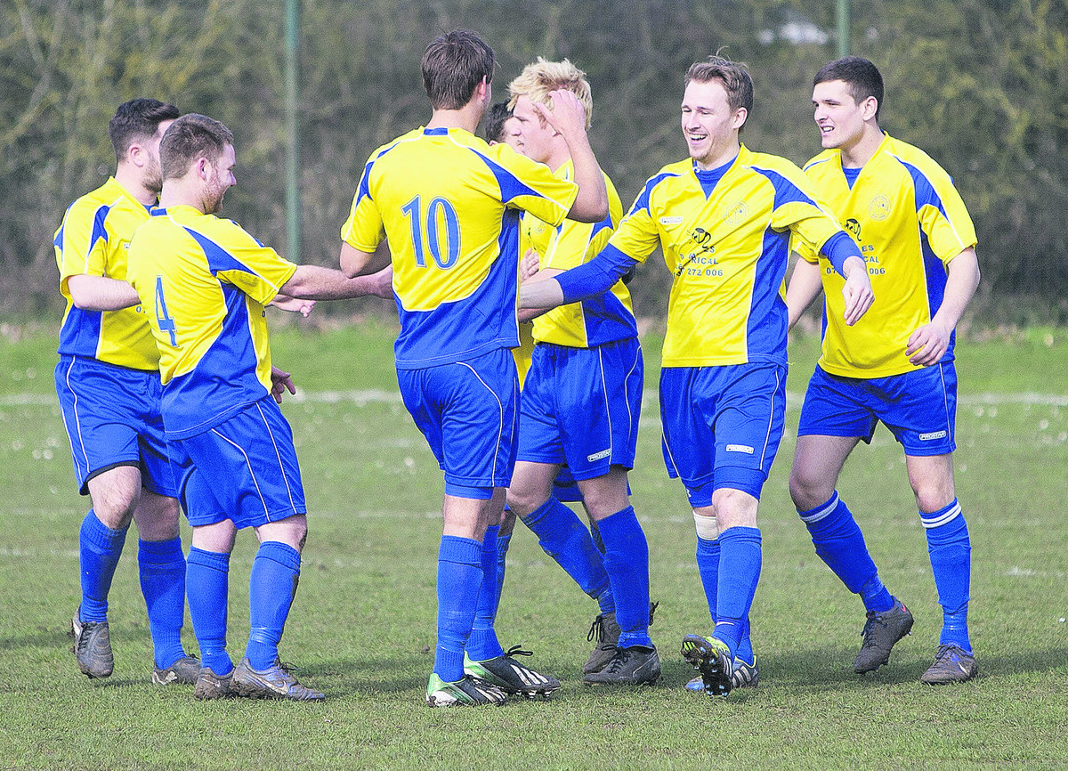 Adam Clarke, second from the right, is congratulated by his teammates after scoring the opening goal for Ducklington in the 3-1 win against Chipping Norton