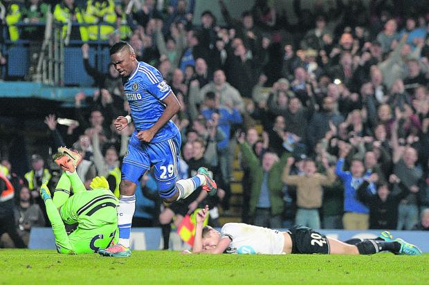 Oxford Mail: Samuel Eto'o celebrates scoring for Chelsea against Tottenham at the weekend. The Blues are over-achieving by leading the Premiership, despite being a 'work in progress'