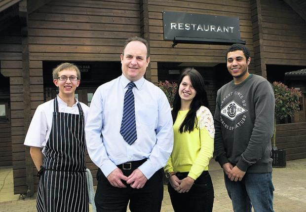 LONGEVITY: Witney Lakes director Sean Parker, second left, with apprentices Karl Franklin, Rosanna Cox and Jake Kemsley