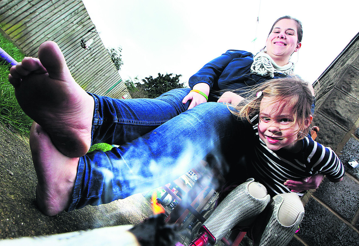 Jenny Daniels is going to be walking across hot coals to raise money for SpecialEffect, the Charlbury charity that helped her daughter Charlotte Nott who had part of both arms and legs amputated after contracting meningitis