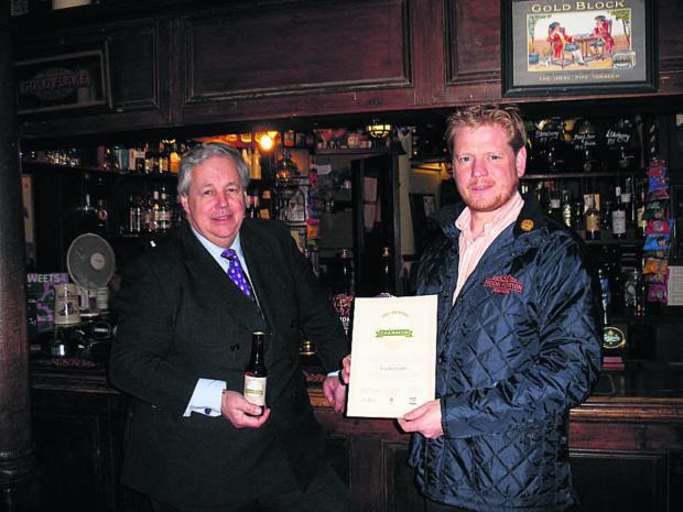 Sir Tony Baldry, left, receives his award from James Clarke