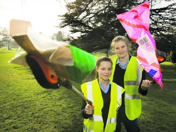Year 9 Headington School girls Emma Windle and Olivia Henderson, both 13, go litter picking; inset, Emilie Walker, 13 Picture: OX65886 Antony Moore