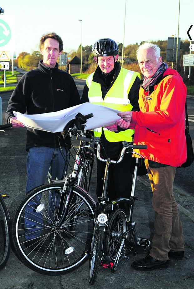 Oxford Mail: Bike Safe chairman Ian Leggett looks at plans for the cycle path with John Griffin and Graham Smith                           Pictures: OX63950 David Fleming