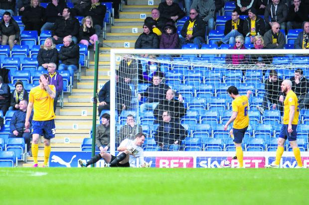 From left: Josh Ruffels, Ryan Clarke, Jake Wright and Tom Newey can't believe it as Chesterfield take an early lead on Saturday. It was to prove the beginning of an afternoon to forget for Oxford United