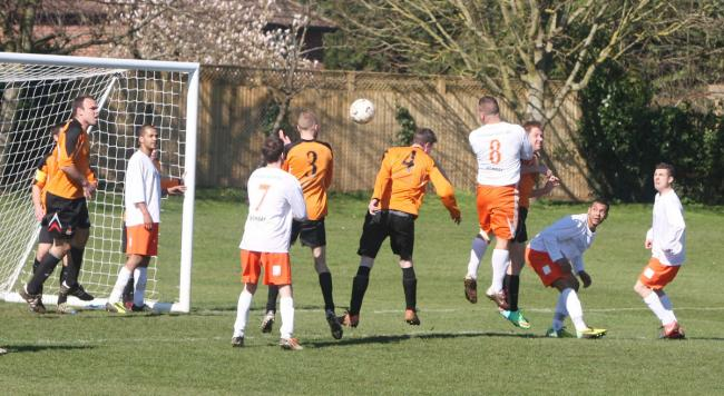 Jericho's Keiran Davis (No8) threatens the Abba Athletic goal during the sides' cup clash which the latter won 1-0